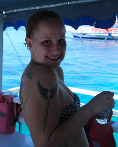 My sister Jen in the Philippines Island Hopping around Samal.